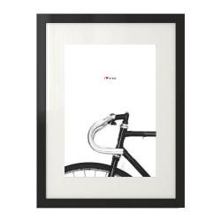 Plakat z rowerem w skandynawskim stylu prezentowany w ramie z passepartout