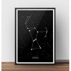 Czarny plakat z gwiazdozbiorem Oriona oprawiony w ramę i postawiony na podłodze