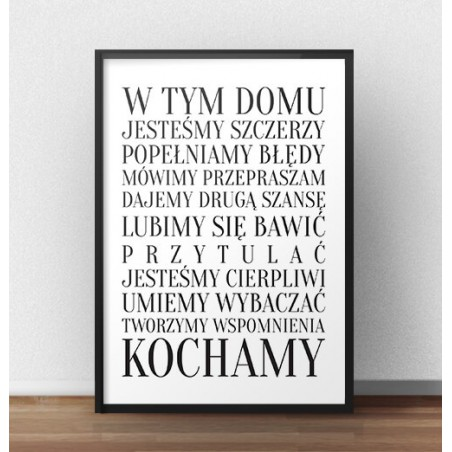 """Plakat z napisem """"W tym domu"""""""